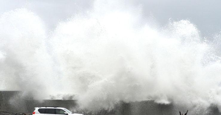 A huge wave breaking a shore in  Aki, Kotchi Prefecture