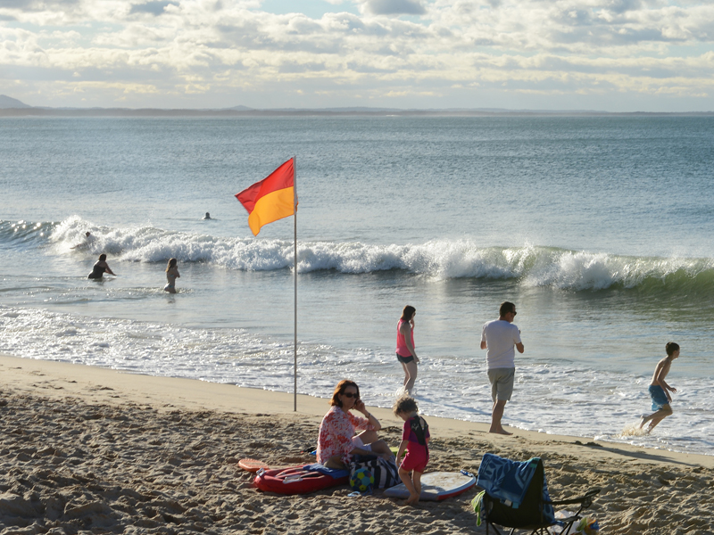 Beachgoers in the resort town of Noosa on the Sunshine Coast