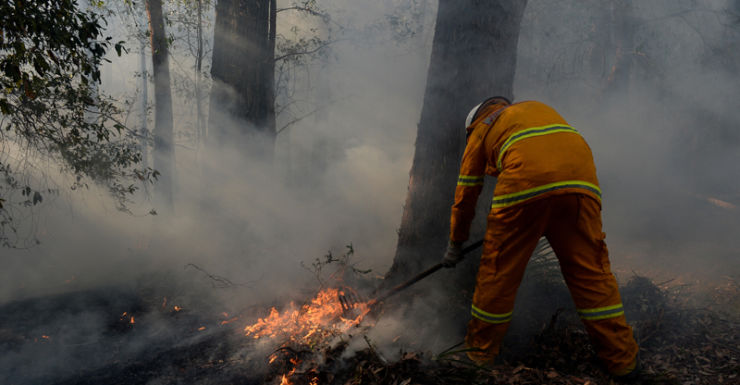 A firefighter mopping up in the Blue Mountains