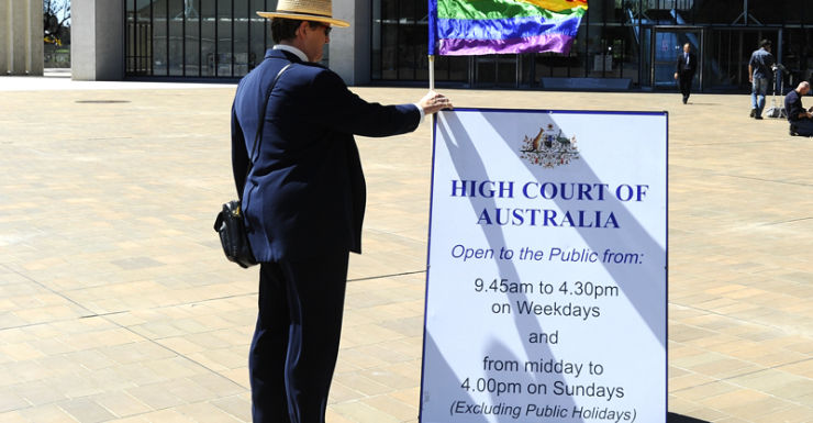 A marriage equality supporter stands outside the High Court