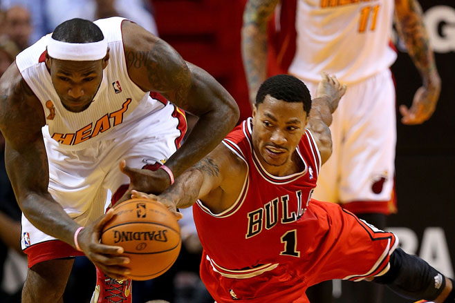 LeBron James of Miami Heat fights for a loose ball with Chicago Bull Derrick Rose
