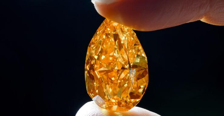 A firey, almond-shaped, rare, orange diamond