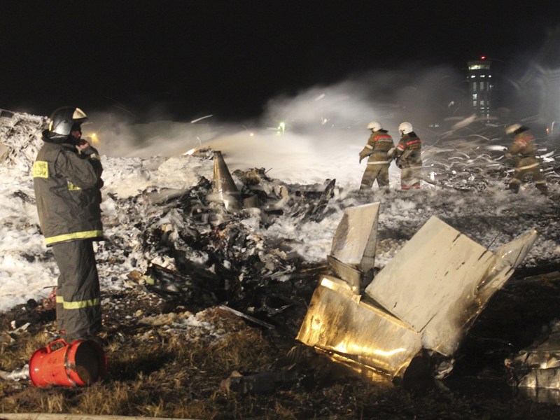 Rescuers work at the crash site of a passenger airliner near Kazan