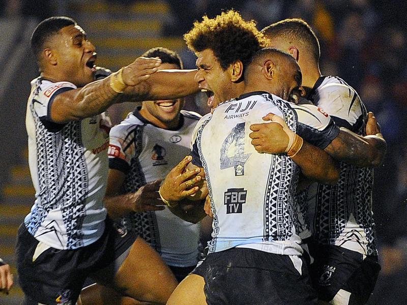 Fiji's Vitale Junior Roqica (C)celebrates after scoring