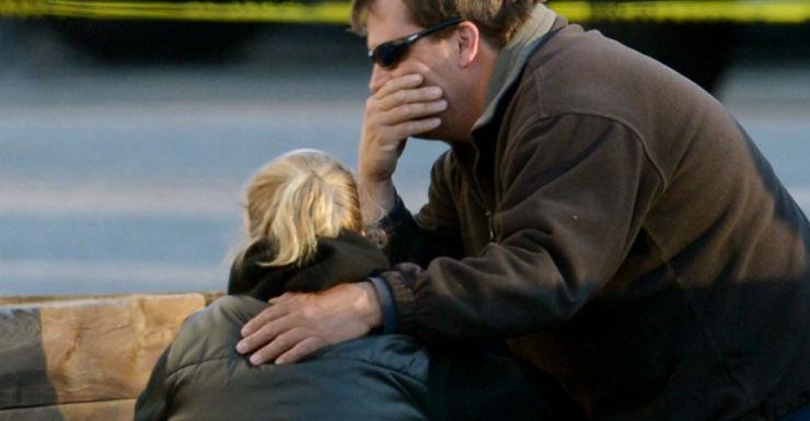People gather outside a fire house near the Sandy Hook school