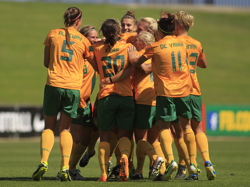 The Australian women's soccer team celebrate after scoring a goal