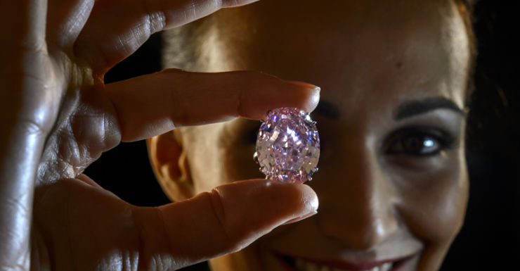 """A woman holding the """"Pink Star"""""""
