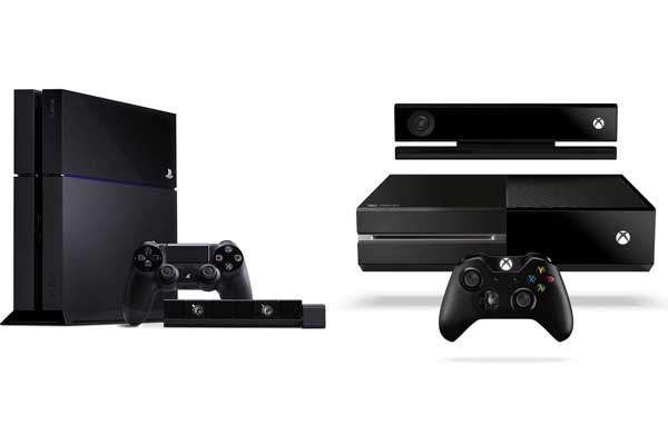 Sony'S PlayStation 4 (PS4, LEFT) next to Microsoft's Xbox One (right).