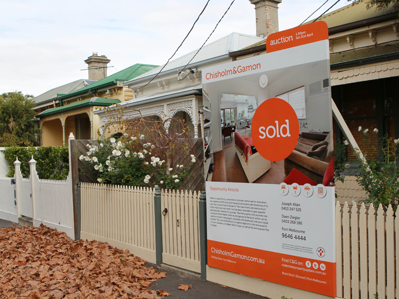 A sold sign in front of a house in Melbourne