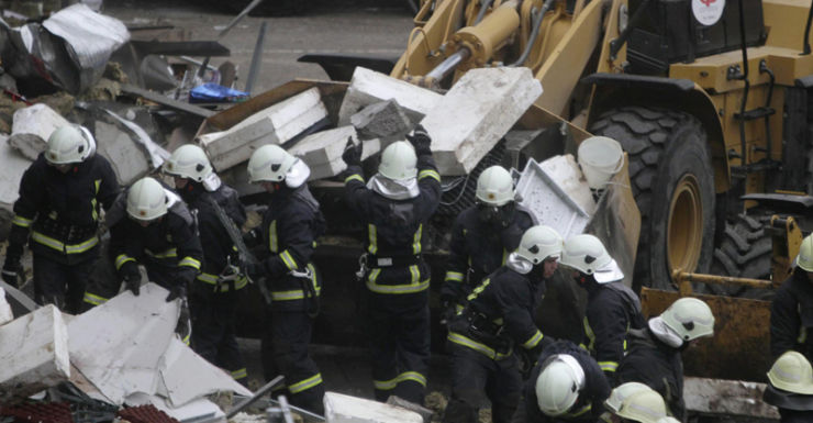 Rescuers at the Latvian supermarket after the roof collapsed