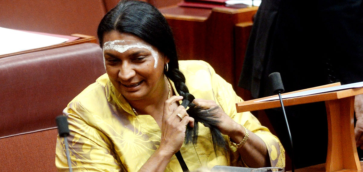 Nova Peris braids her hair before her maiden speech in the Senate. Photo: AAP.