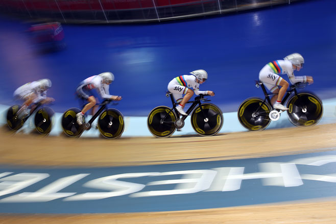 Britain's women's teams pursuit cyclists on their world record breaking final