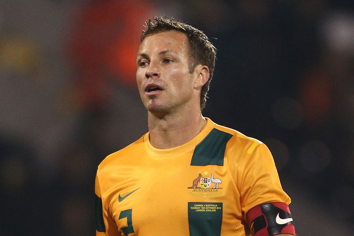Lucas Neill playing for the Socceroos