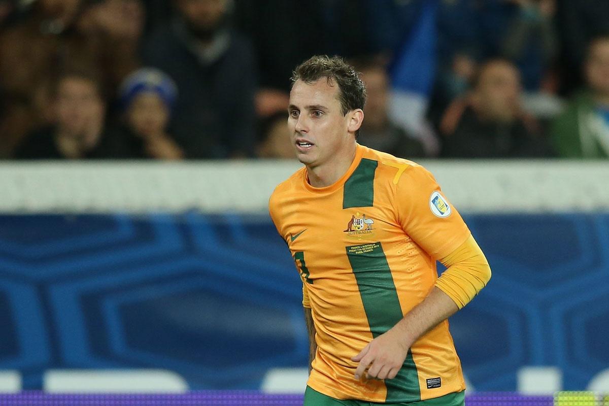 Luke Wilkshire playing against France