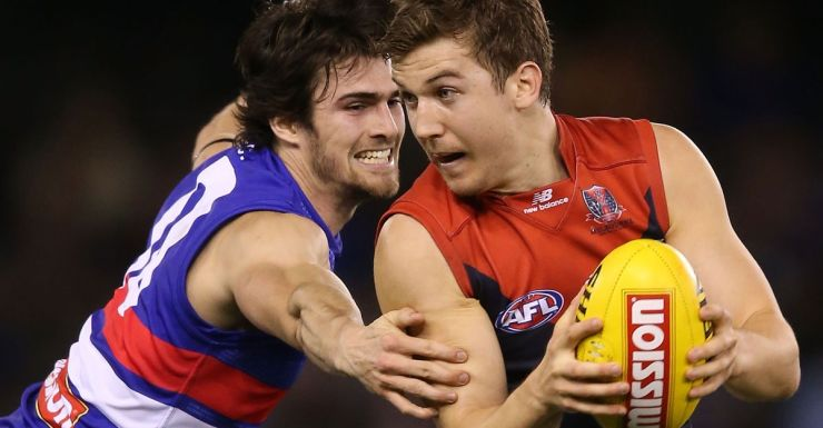 Melbourne co-skipper Jack Trengove breaks a tackle during the 2013 season.