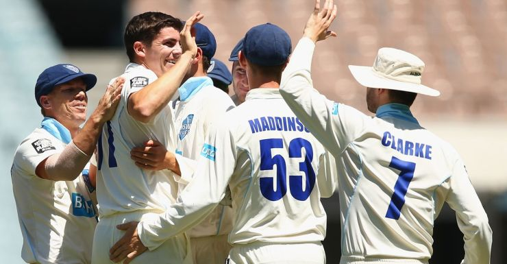 NSW's Sean Abbott celebrates after taking the wicket of Victoria's Aaron Finch.