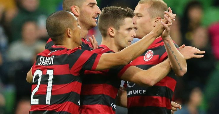 Wanderers players celebrate Shannon Cole's goal