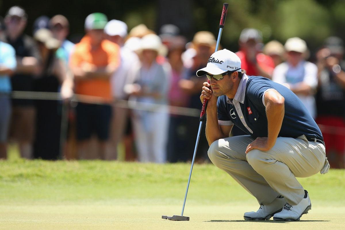 Adam Scott lines up a putt