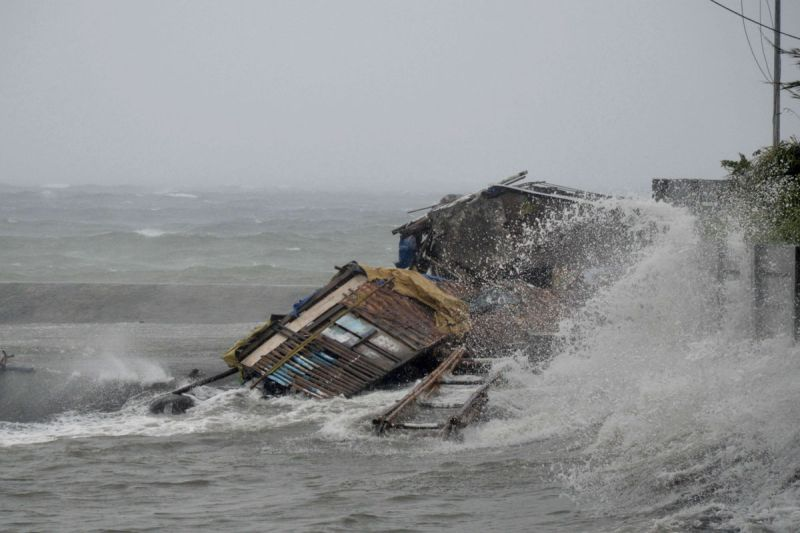 A house is engulfed by the storm surge from powerful typhoon Haiyan.