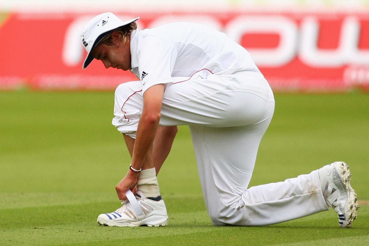 Stuart Broad struggles with his boot.