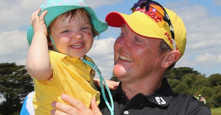 Jarrod Lyle hugs daughter Lusi after completing the Australian Masters.
