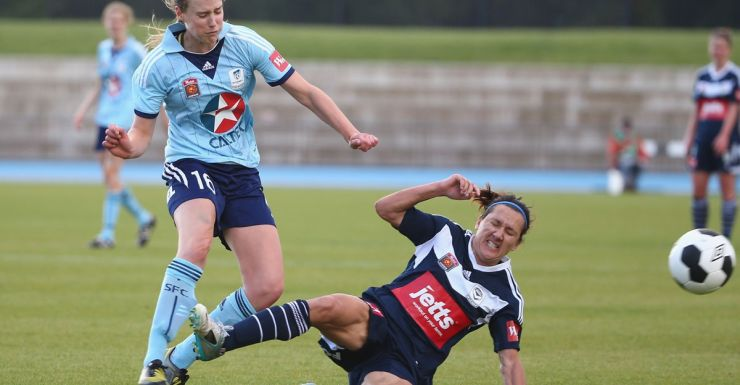Ellyse Perry is fouled during a W-League match.