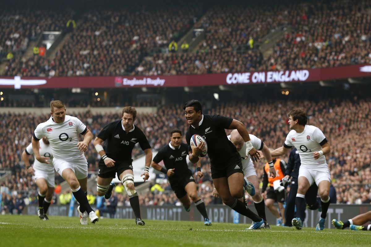 New Zealand wing Julian Savea scores against England.
