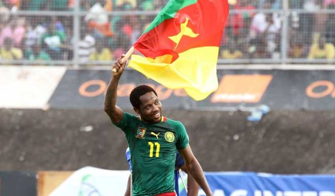 Forward Jean Makoun celebrates Cameroon's qualification the 2014 World Cup.