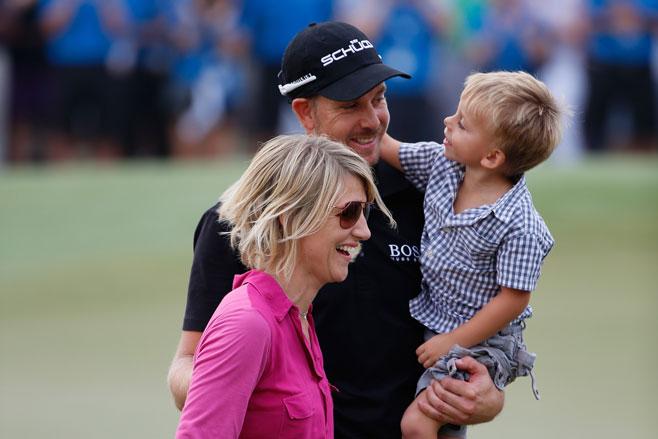 Henrik Stenson celebrates his Dubai win with wife Emma and son Karl.