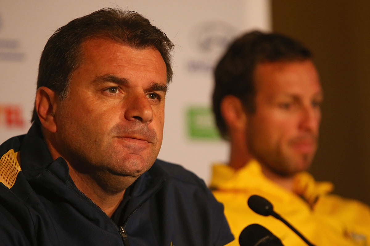 Socceroos coach Ange Postecoglou and skipper Lucas Neill.
