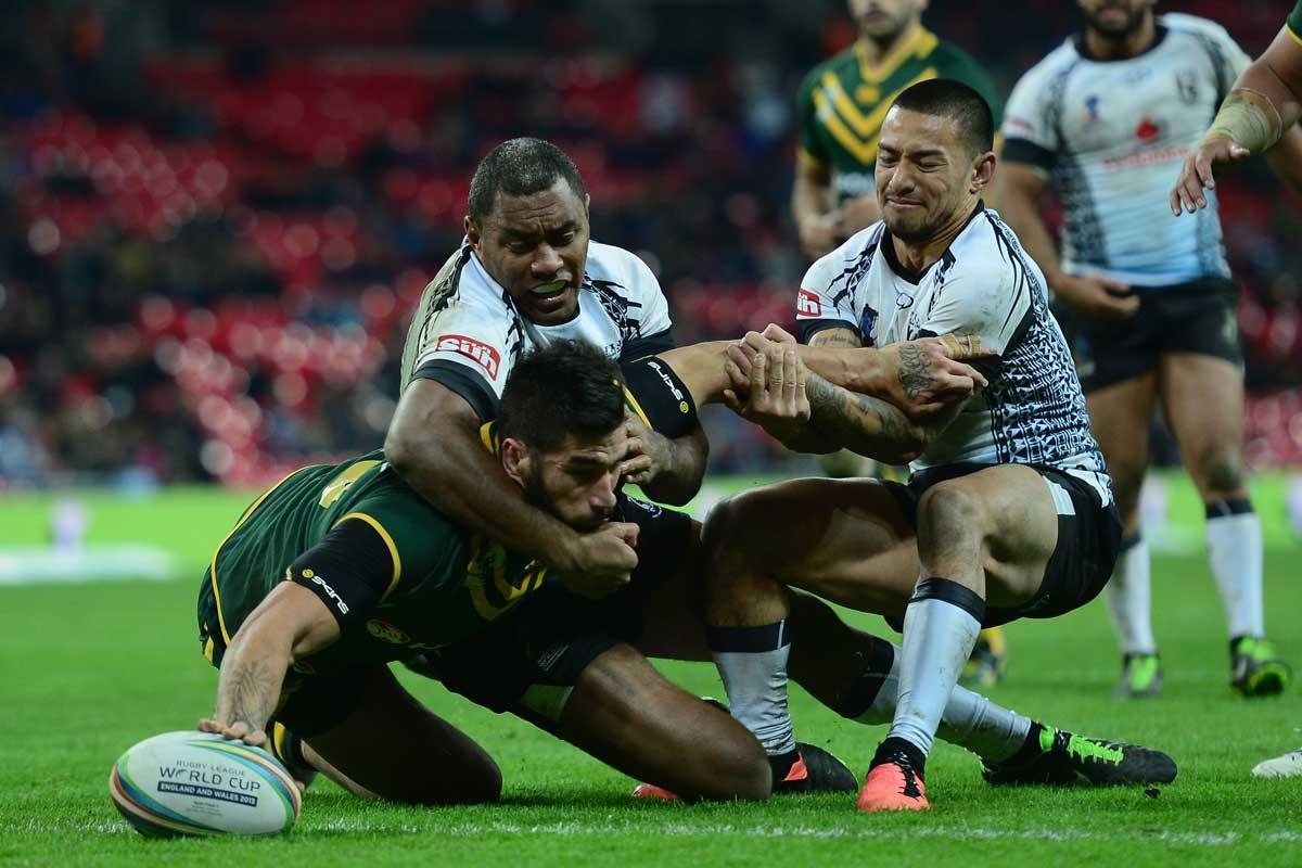 Darius Boyd of Australia scores a try against Fiji.