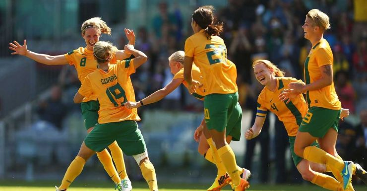 Katrina Gorry of the Matildas (No. 19) and teammates celebrate her goal against China.