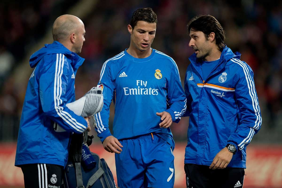 Cristiano Ronaldo leaves the pitch with support from Real Madrid medical staff.