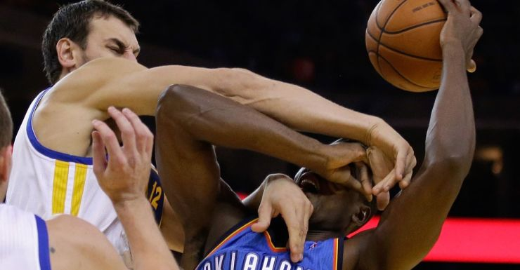 Andrew Bogut tangles with an opponent.