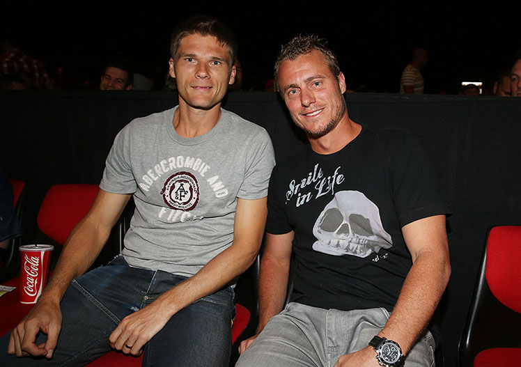 C'mon! Watching the boxing action are tennis pros Peter Luczak and Lleyton Hewitt.