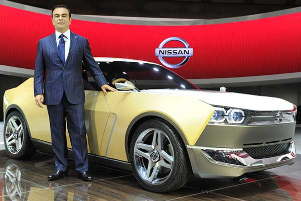 Nissan Motor President Carlos Ghosn with the IDx Freeflow.