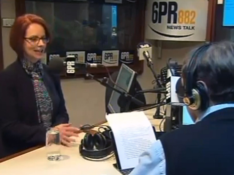 Julia Gillard (L) being interviewed on radio by Howard Sattler