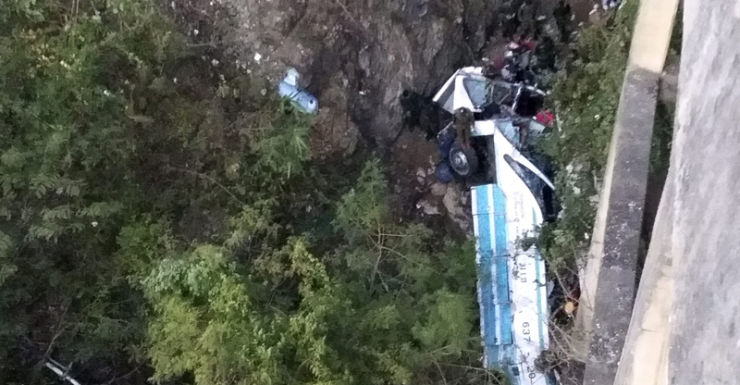 A damaged bus after it crashed into a ravine, Thailand