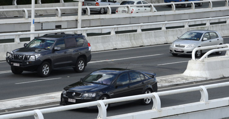 Cars travel along the Pacific Motorway in Brisbane