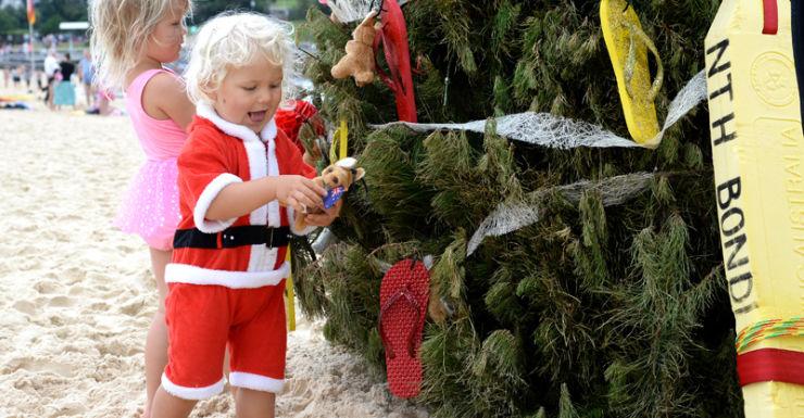 James Morgan plays near a Christmas tree erected on Bondi Beach
