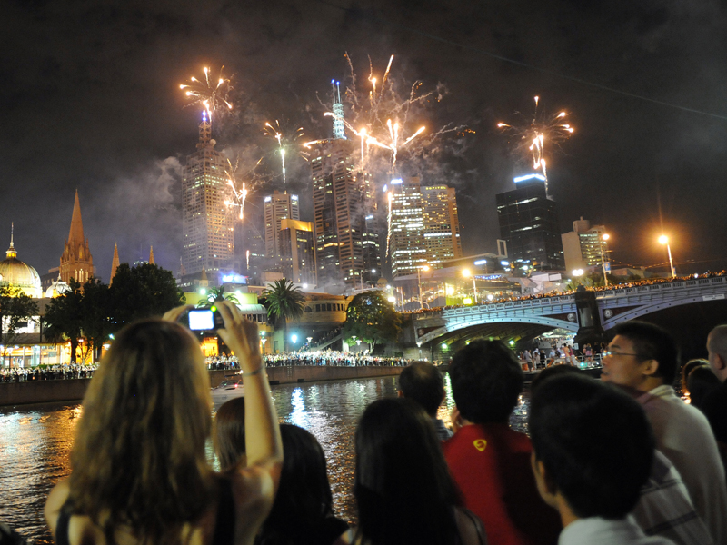 Melbourneans watch the fireworks display over the city