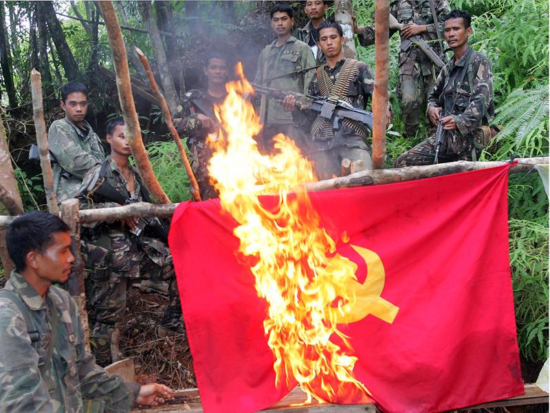 Philippine military burn a communist flag