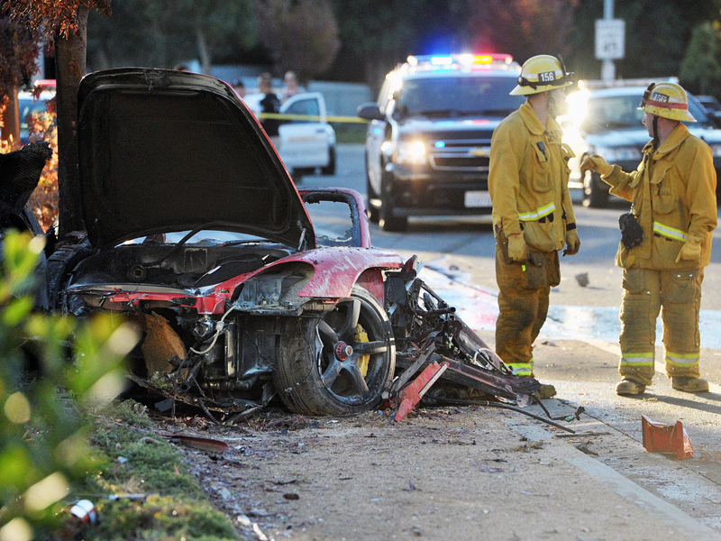 The wreckage of a Porsche that crashed in Valencia