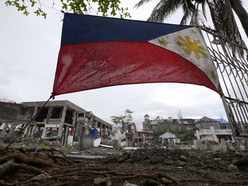 A Philippine flag is placed at the coastal township of Basey