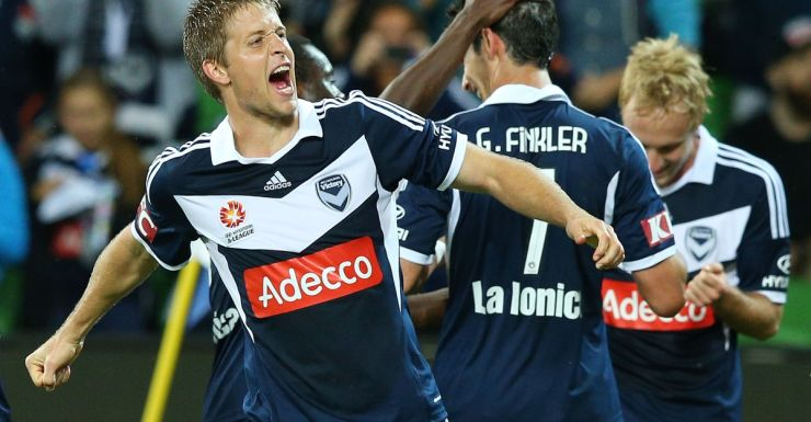Adrian Leijer leads the Melbourne Victory celebrations.