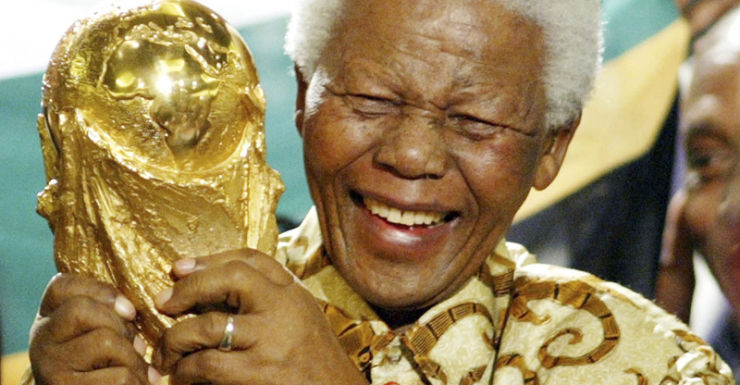 Nelson Mandela lifts the World Cup trophy in Zurich