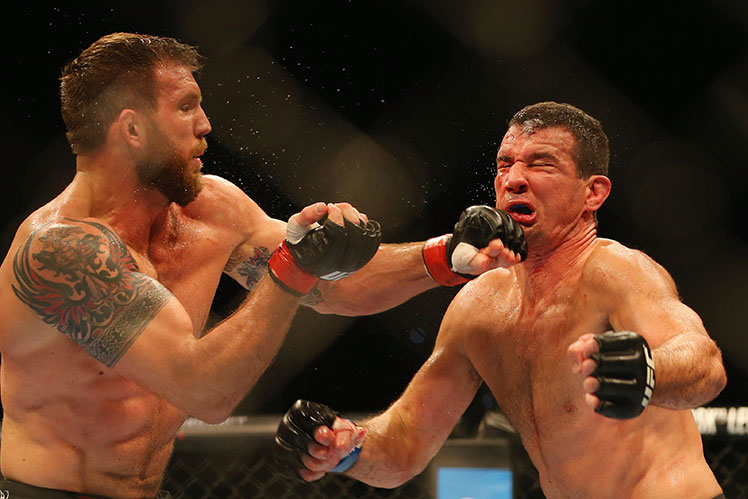 Ryan Bader (left) lands a hard left to the chin of Anthony Perosh during their UFC light heavyweight bout in Brisbane.