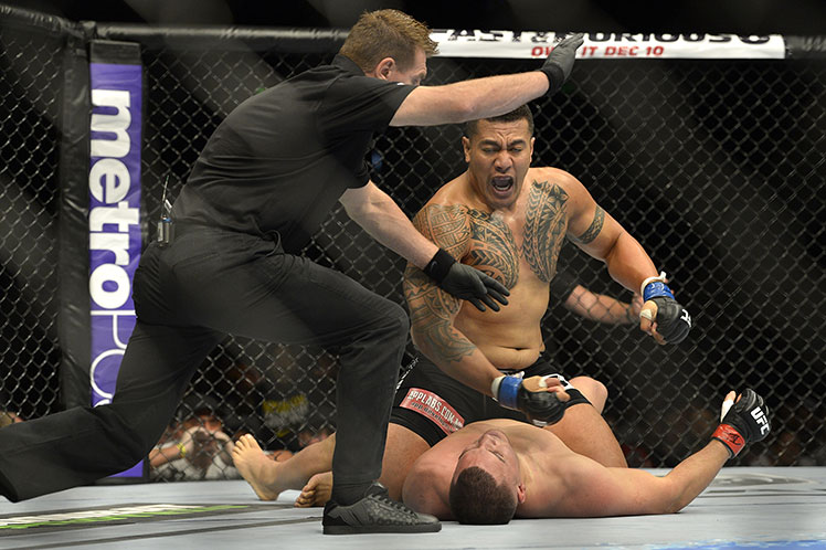 KO king ... Soa Palelei knocks out Pat Barry in their UFC heavyweight bout in Brisbane.