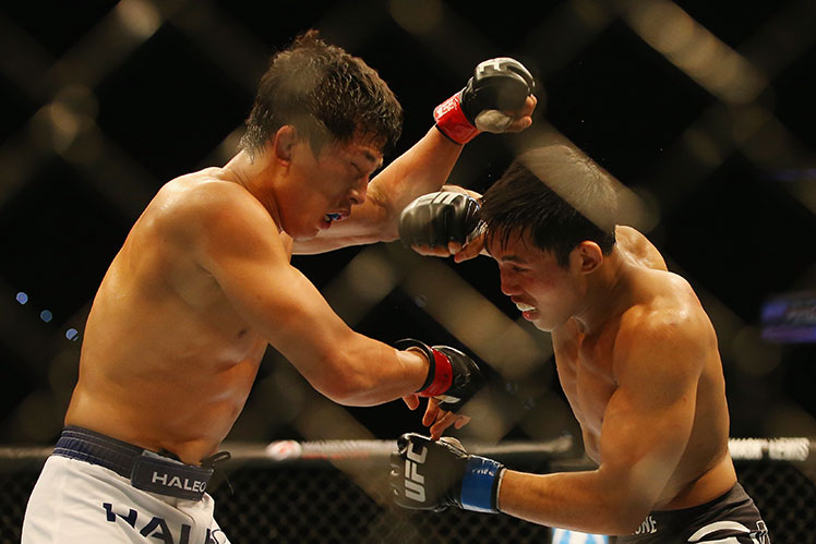 Takeya Mizugaki (left) and Nam Phan throw down in their UFC featherweight bout in Brisbane.