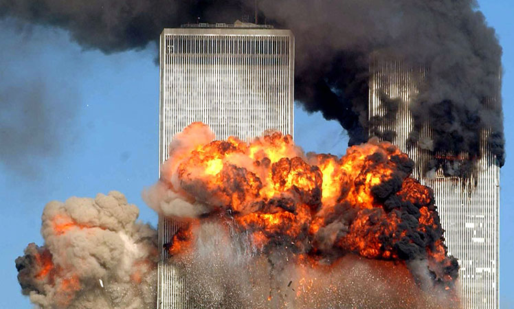 Terror strikes: An explosion after a plane flies into the twin towers.